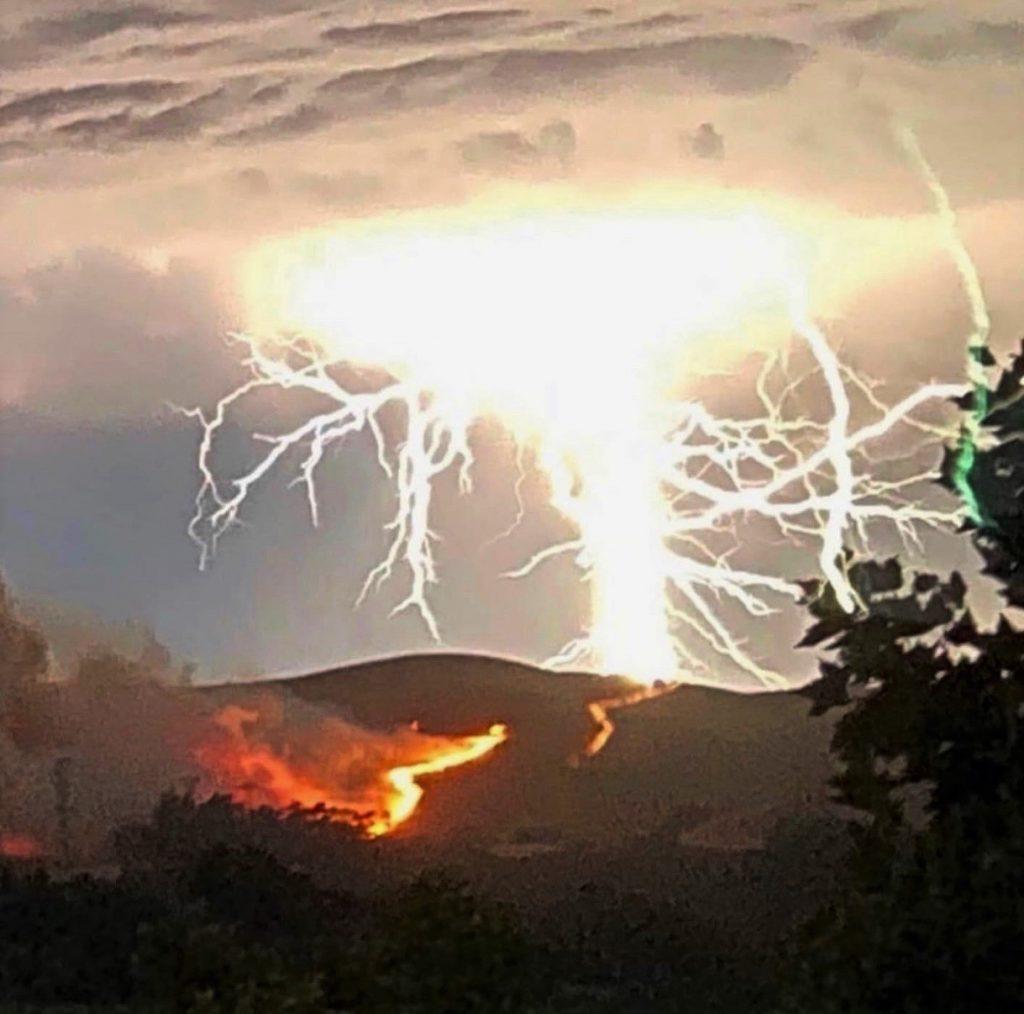Lightning and fire on a hillside.
