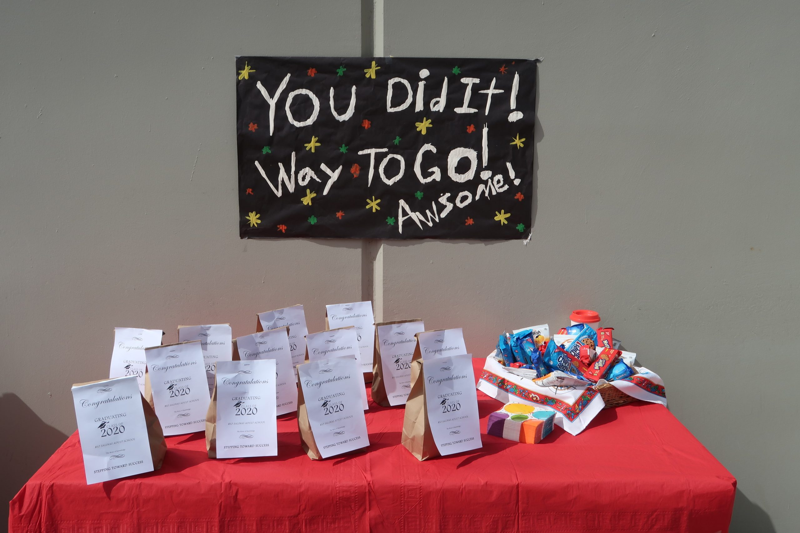 "A table with a sign that says ""You did it! Way to go!"""