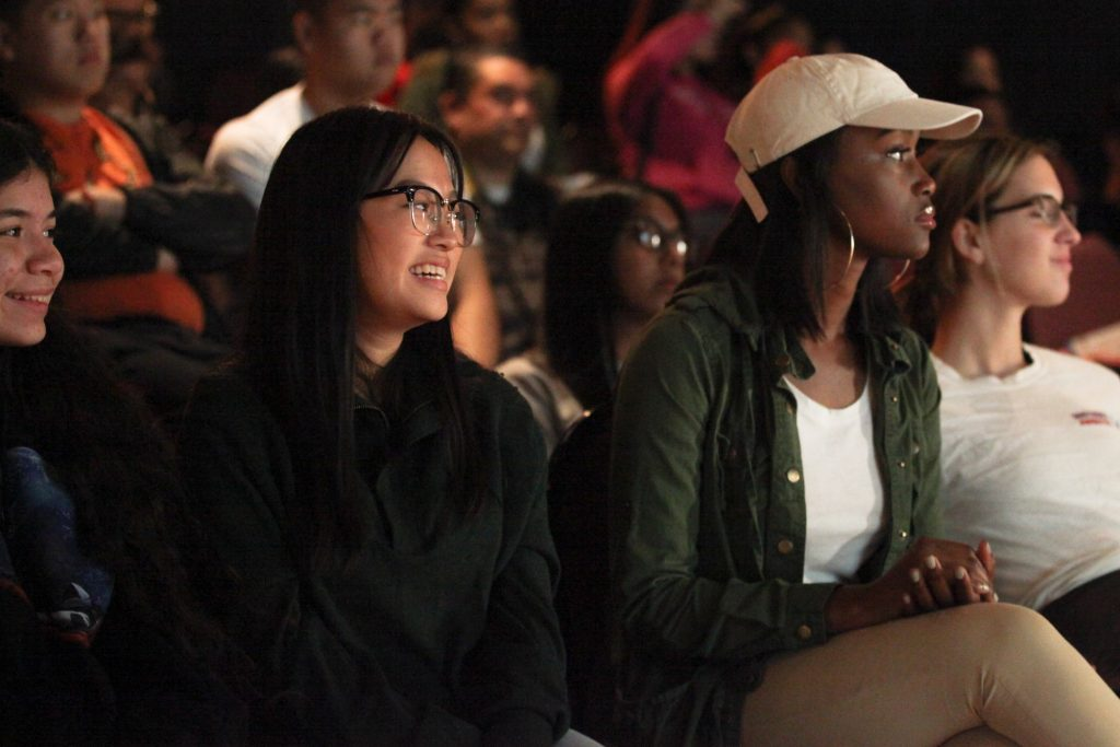 High school students smile while watching a CDCR K-9 demonstration.