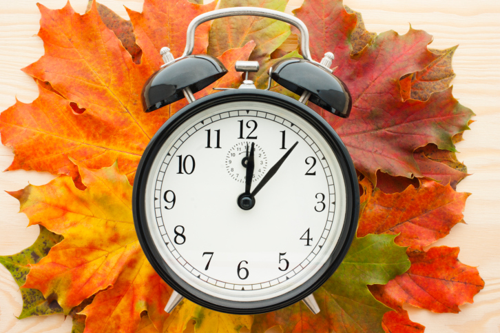 Fall leaves and a clock.