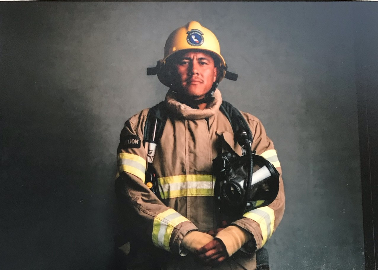 Jose Morales in firefighting gear.