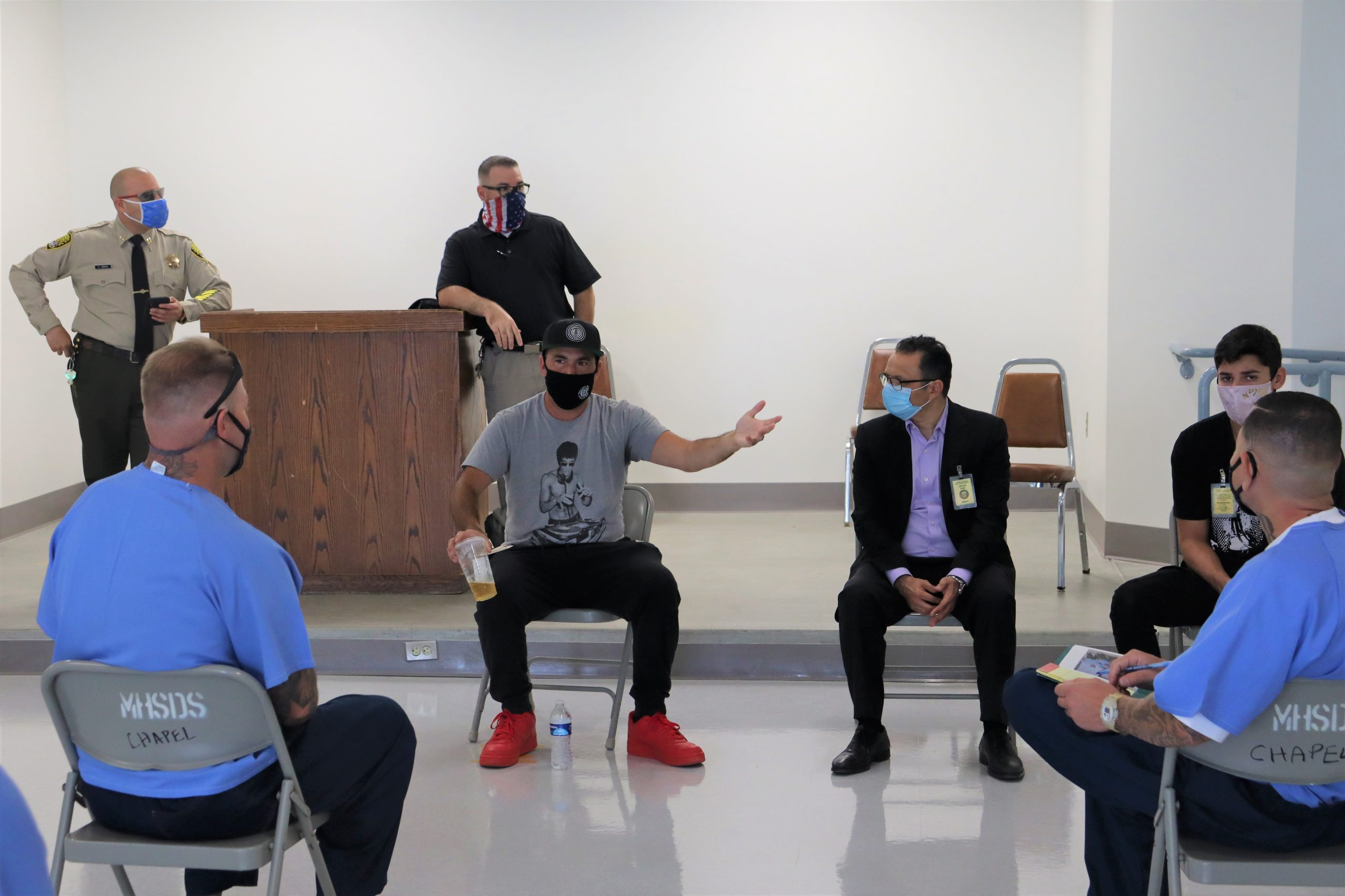 RJD Correctional Facility Inmates listen to men speak.