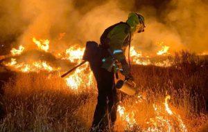 Michael Gebre fights a fire.