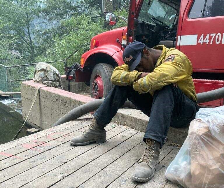 CAL FIRE firefighter Michael Gebre gets some rest.