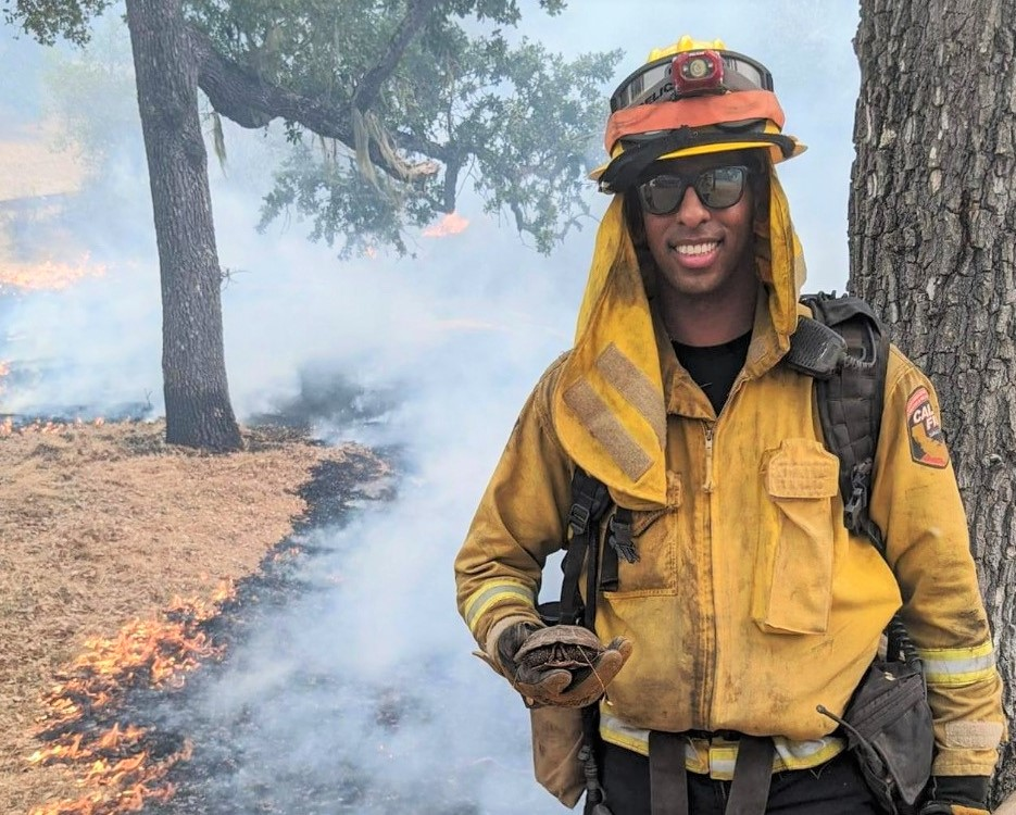 Firefighter Michael Gebre holds a turtle he rescued.