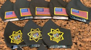 Masks with CDCR logos and American flags.