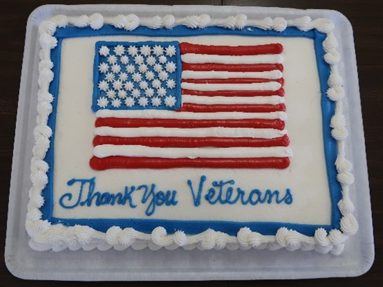 A Veterans Day cake is decorated with the U.S. flag.