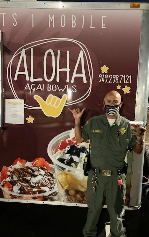 "Correctional officer at food truck makes Hawaiian hand gesture for ""Hang loose."""