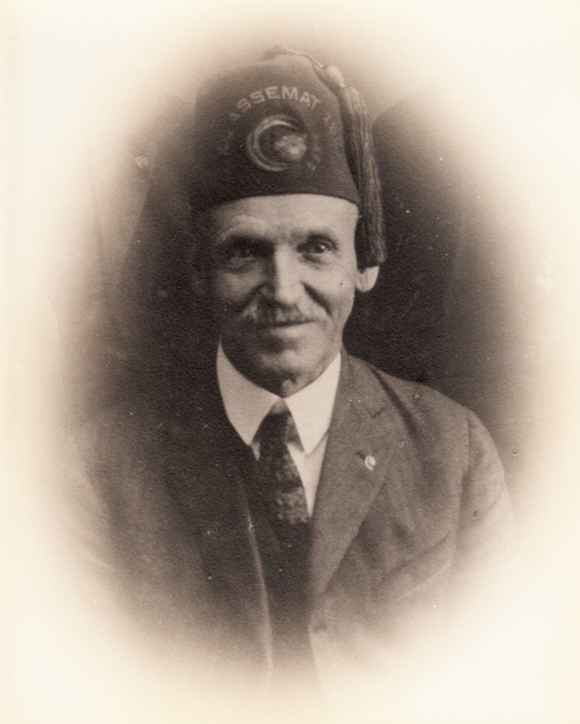 Former prison guard Henry Coleman Herrill family photo wears a lodge hat.