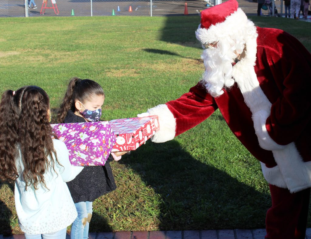 CDCR staff give children gifts for the holidays.