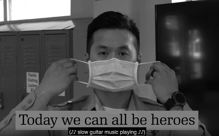 Office puts on mask. Text beneath says 'We can all be heroes.'