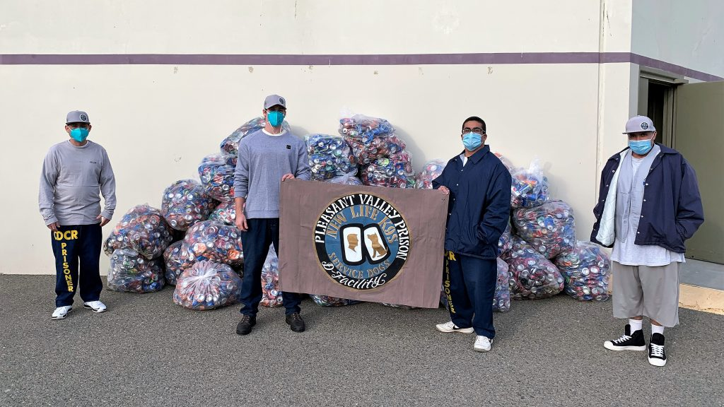 Pleasant Valley Facility D residents and a stack of recyclable cans and bottles.
