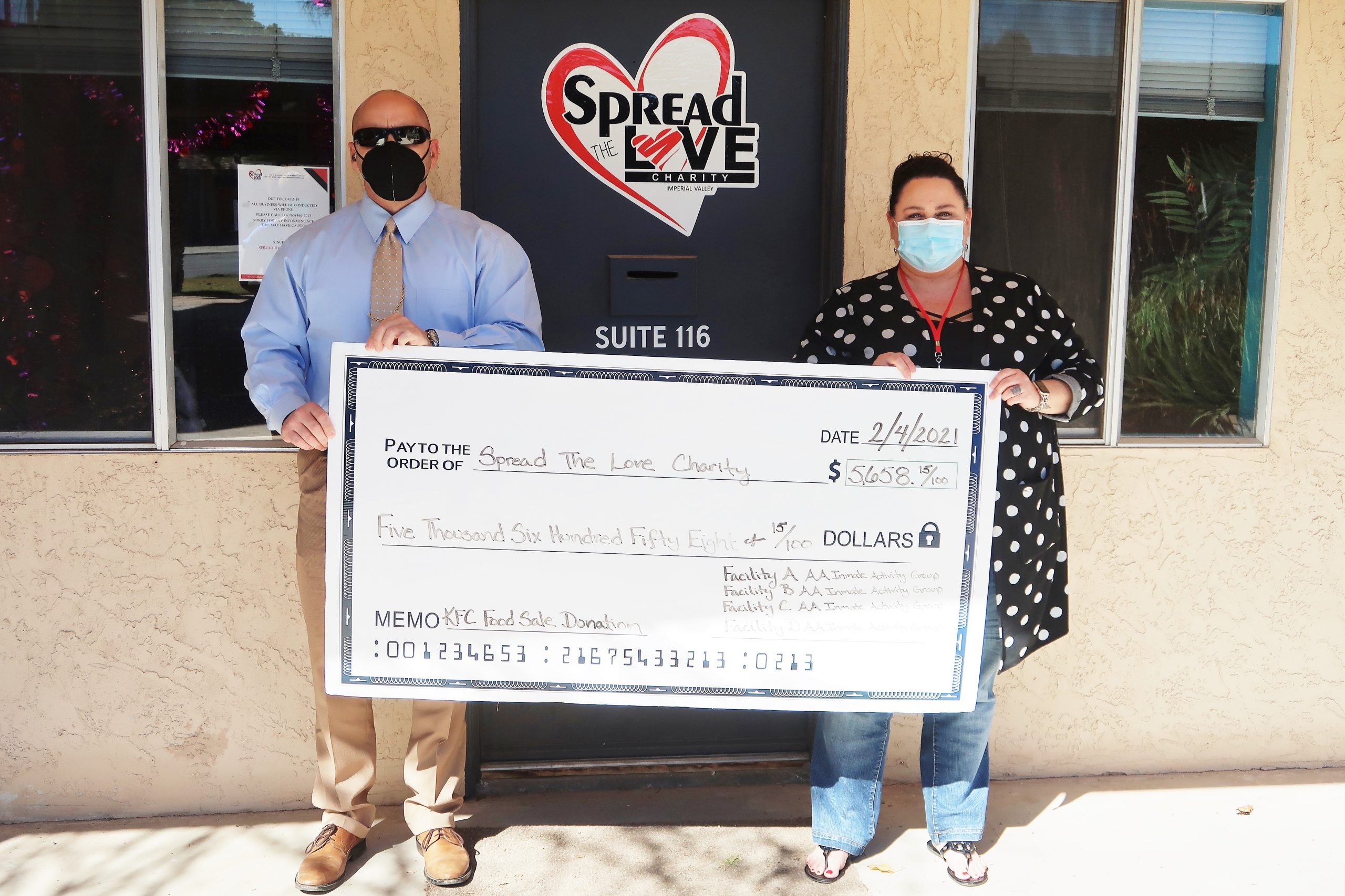 A check for Spread the Love Charity.