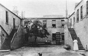 Early female prison staff supervised women at San Quentin, like in this early courtyard image.
