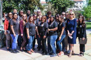 Office of Victims and Survivors staff stand in a park.