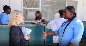 Diversity, equity, inclusion are demonstrated through still images such as women employees and inmates.