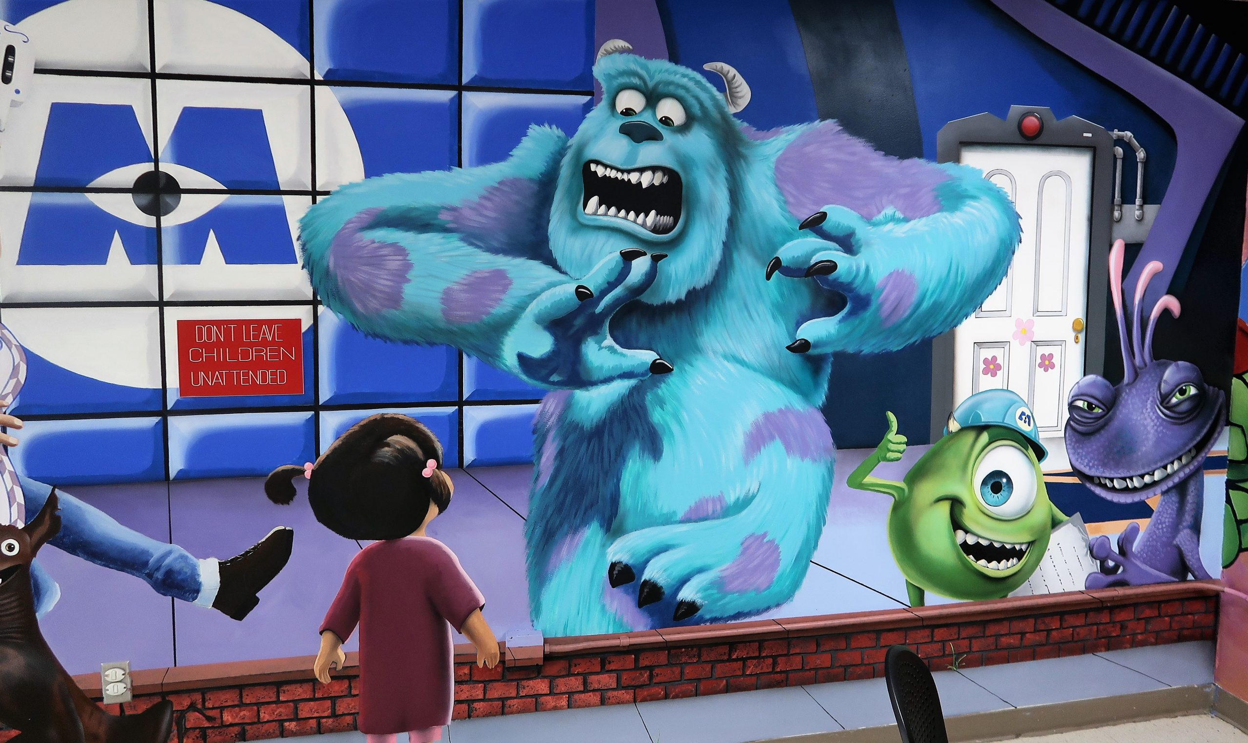 Avenal Prison visiting area featuring characters from Monsters Inc.
