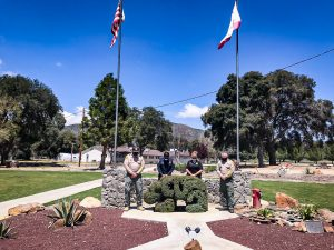 CDCR staff bow heads in moment of silence for crime victims.