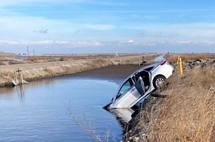 A car in a canal.
