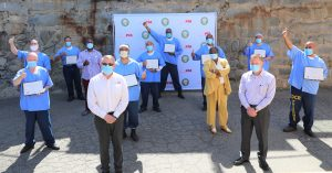 CALPIA soft skills training participants and officials stand in Folsom prison.