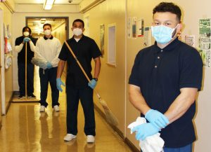 Four incarcerated DJJ youth hold cleaning equipment as they learn workforce readiness skills.