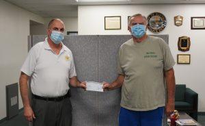 CVSP warden presents a check to a Blythe charity representative.