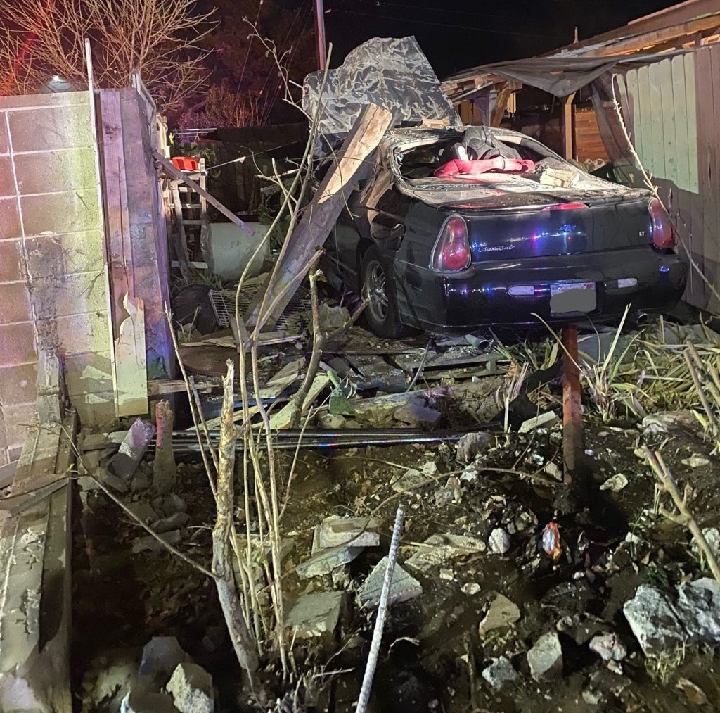 Car crashed through brick wall and into the corner of a house.