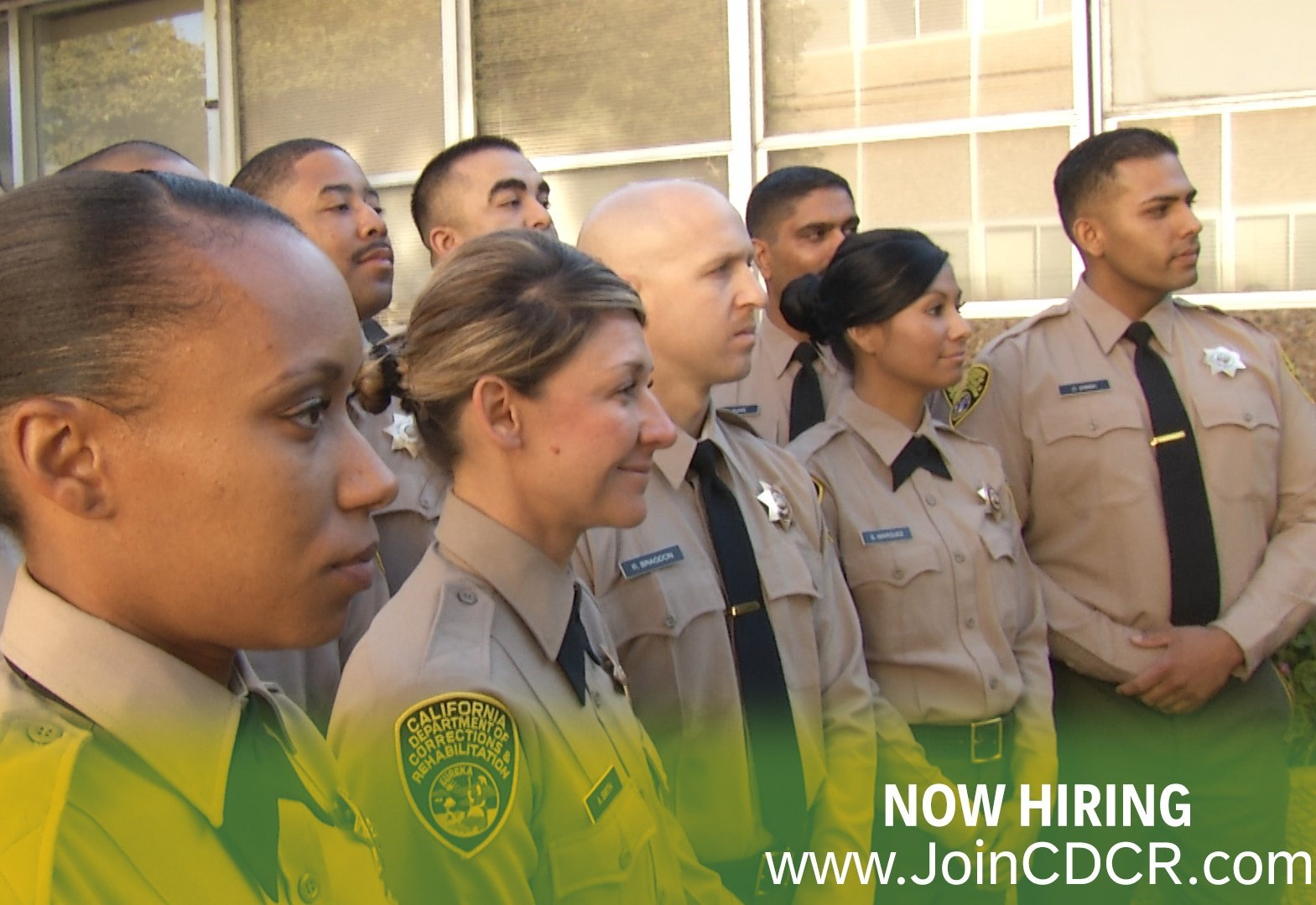 Two lines of men and women in Correctional Officer uniforms