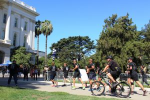 Special Olympics Torch Run people with California Capitol in background.