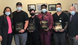 Six people wearing masks facing the camera