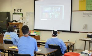 Valley State Prison students look at a video screen.