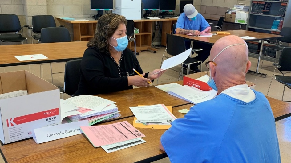 College records technician helps incarcerated student enroll in classes.