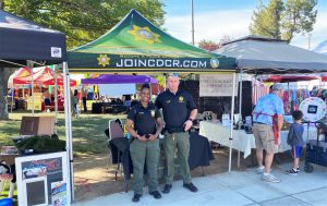 Two CDCR recruitment team members at booth.