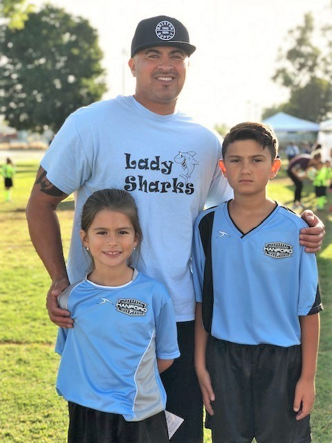 Man coaches youth sports.
