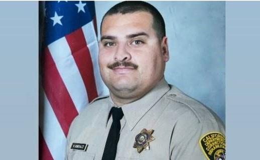 Victor Gonzalez in correctional officer uniform,.