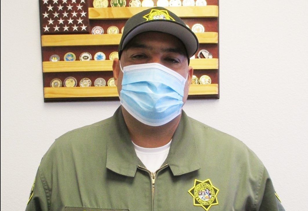 A correctional officer with B Diaz on his uniform.