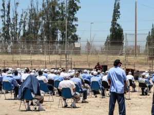Facility C at CTF with speaker and inmates