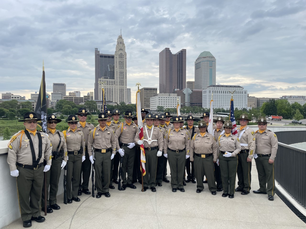 Honor Guard with city skyline in background.