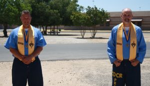 Two graduates at Merced College.