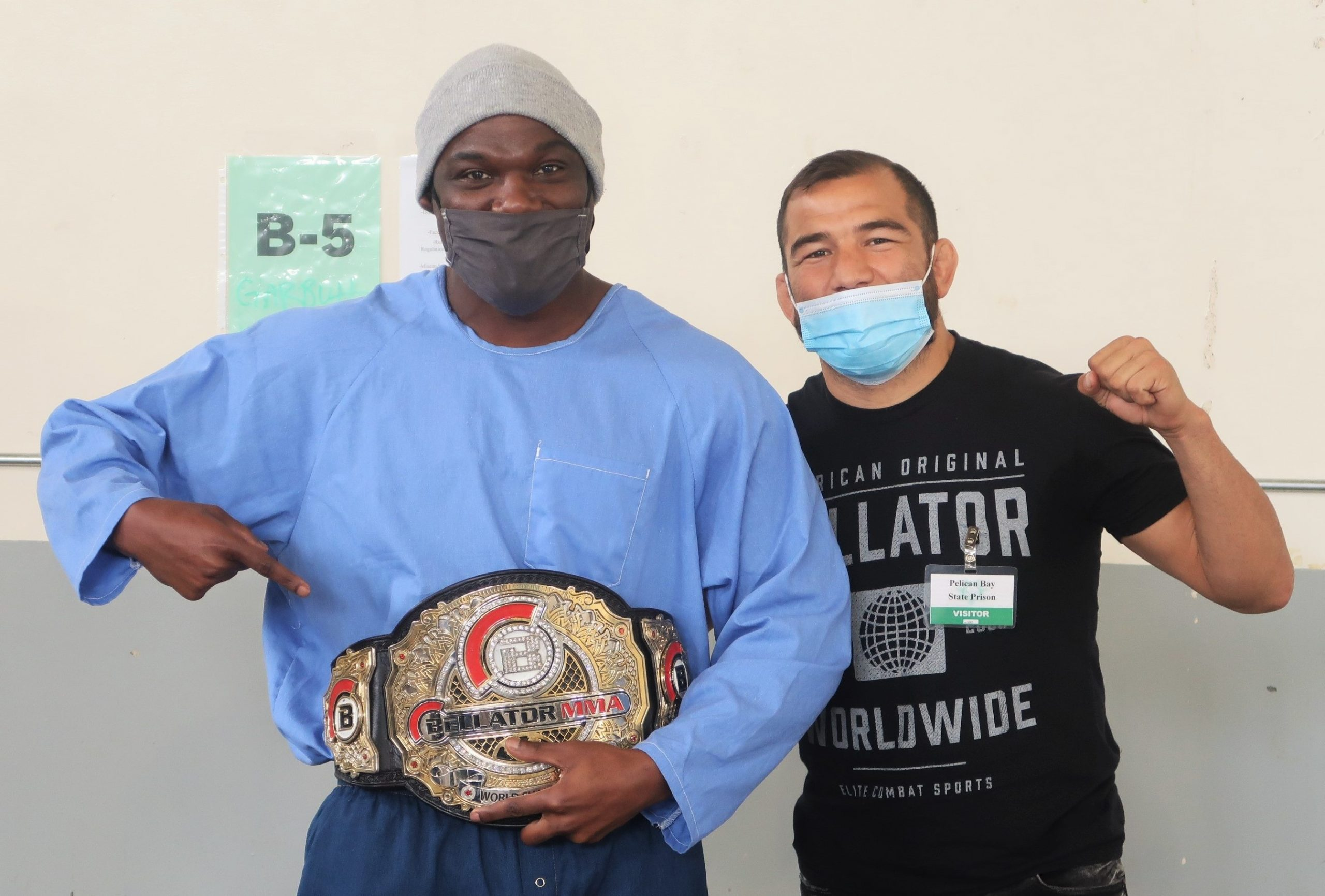 World champion belt and two men at Pelican Bay State Prison.