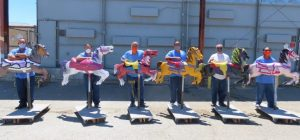 Avenal prison inmates and colorful carousel horses.