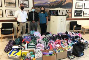 Calipatria prison staff and boxes of school supplies.