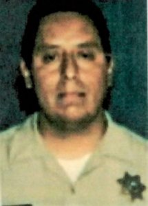 Edward Vargas in correctional officer uniform.