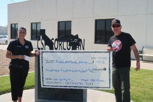 Corcoran prison staff present check to help Fresno kids.