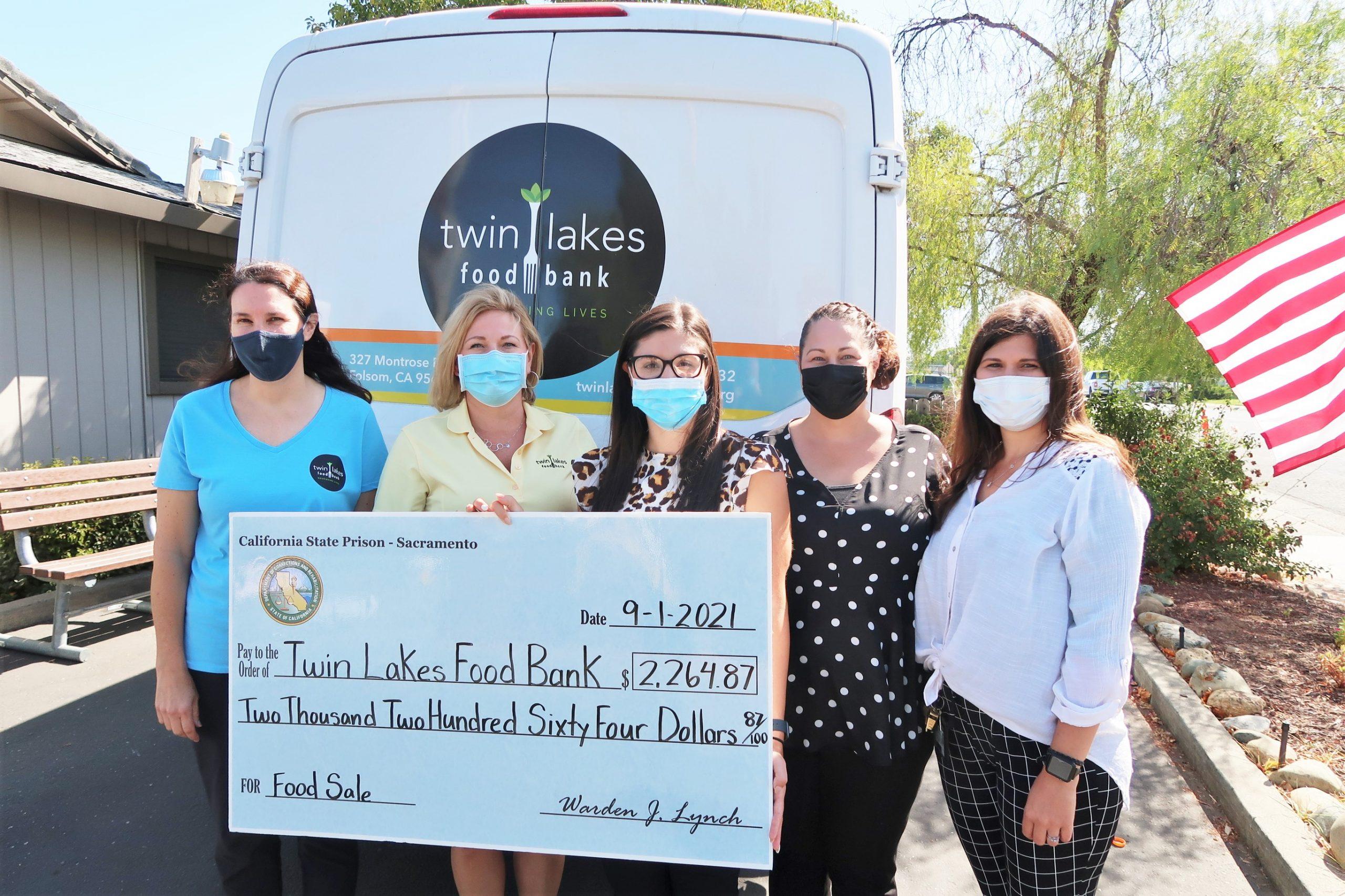 CSP-Sacramento staff donates $2,200 to Twin Lakes Food Bank.