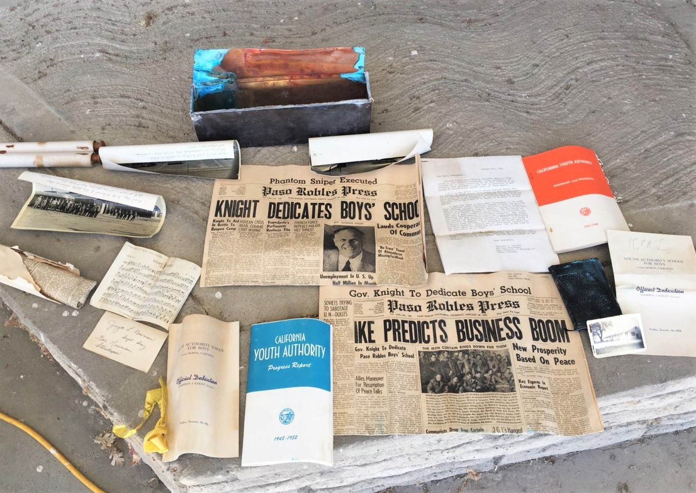 Paso Robles facility time capsule contents show newspapers, photos and booklets.