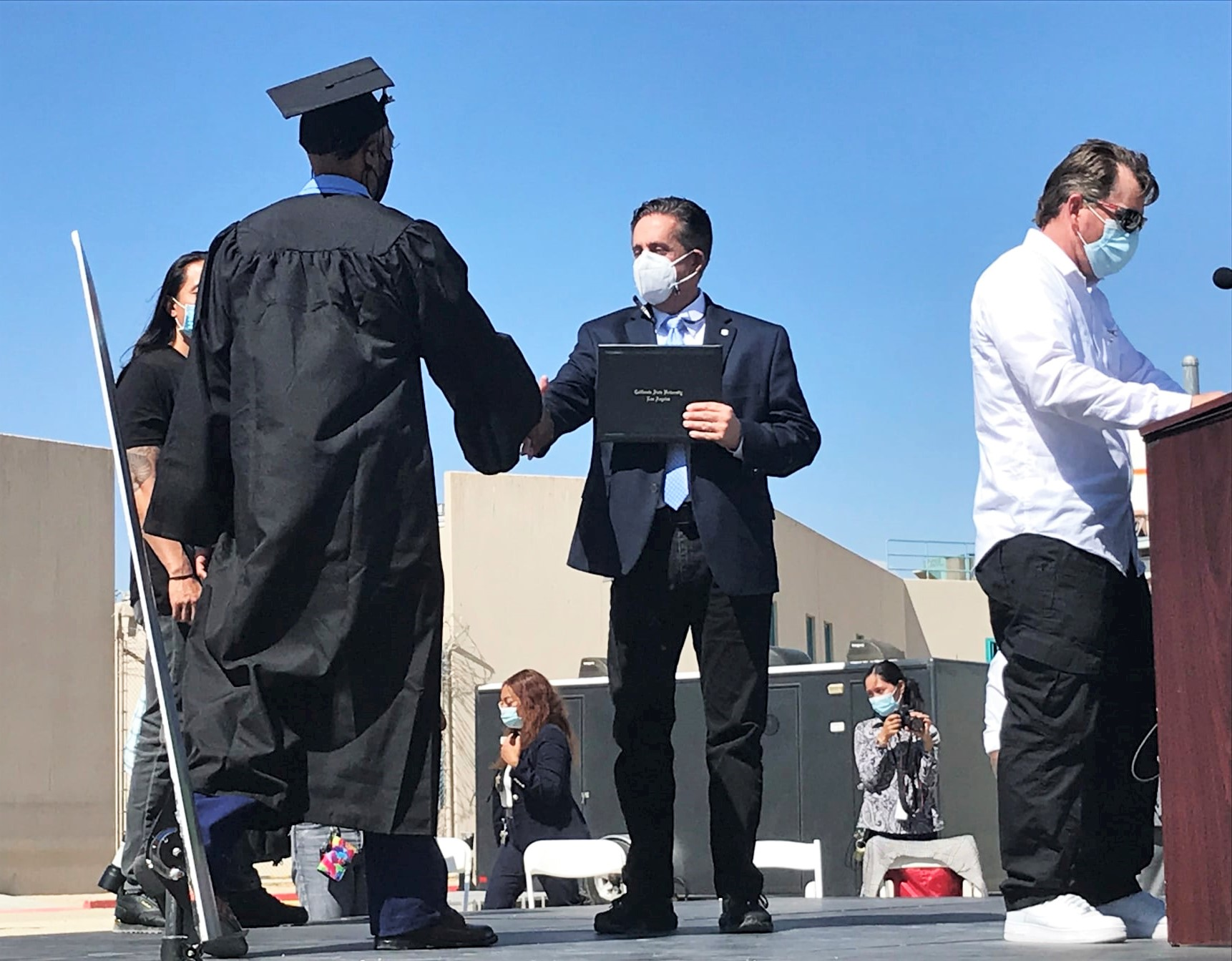 A man receives a degree during a ceremony.