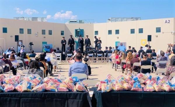 Prison yard and graduation ceremony.