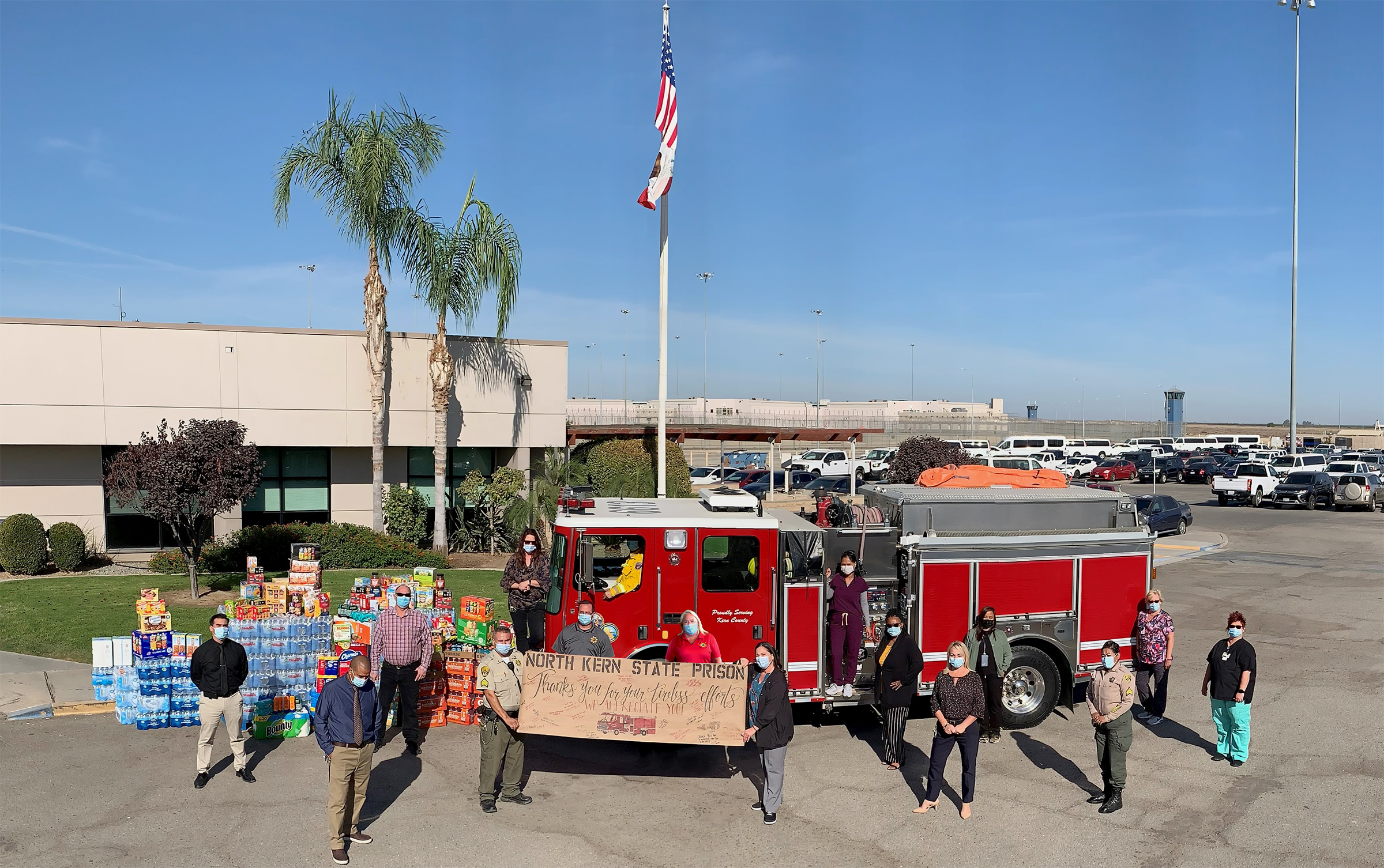 NKSP prison staff and a fire engine with supplies to donate.