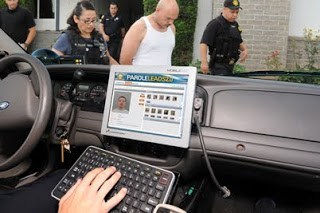 hand typing on car dashboard computer